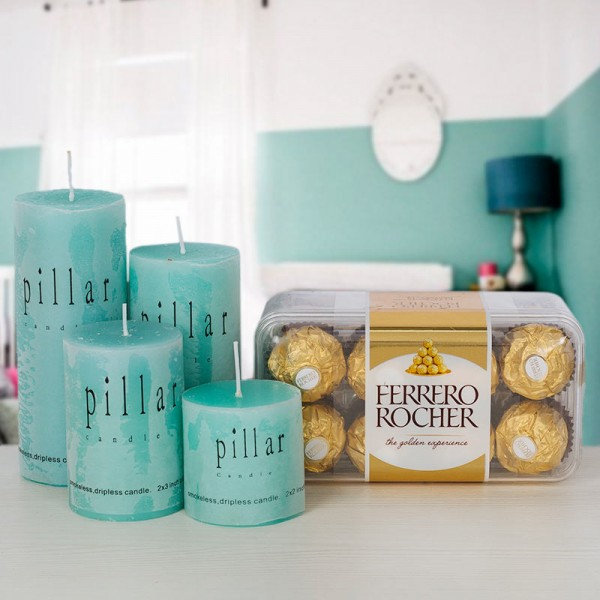 Basket of scented candles and chocolate