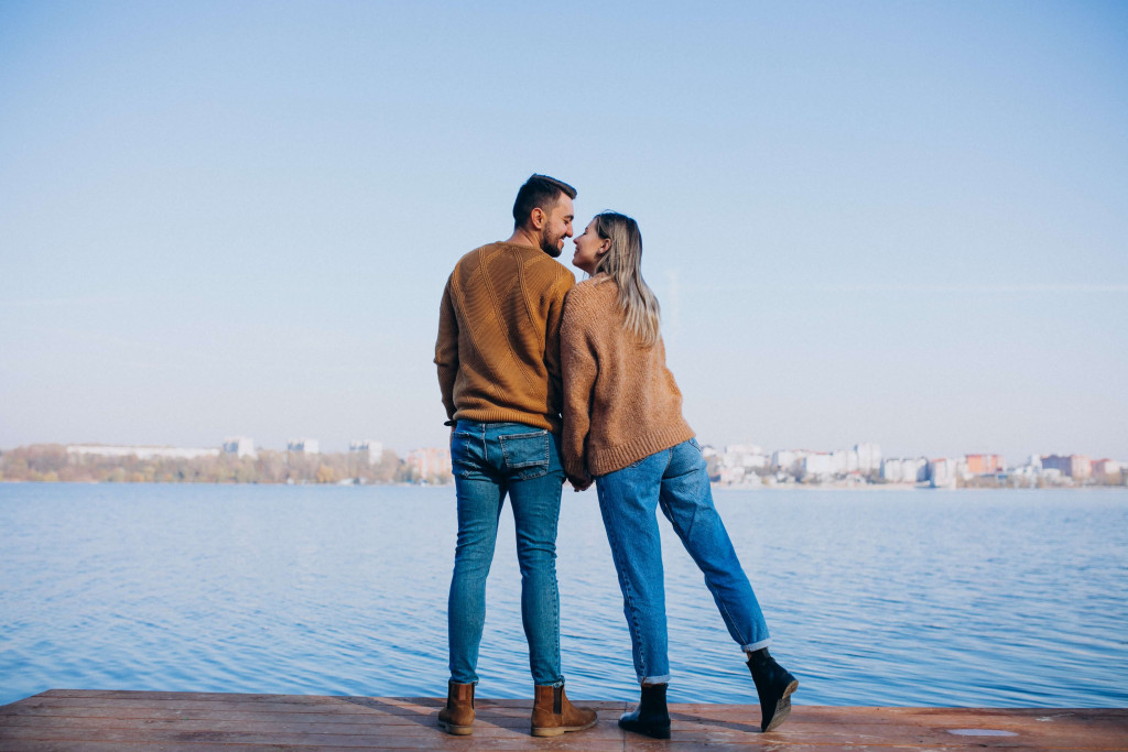 couples standing on the river side