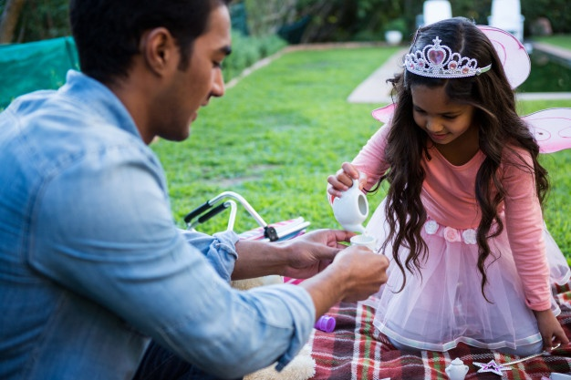 father-daughter-having-toy-tea-party_107420-72066