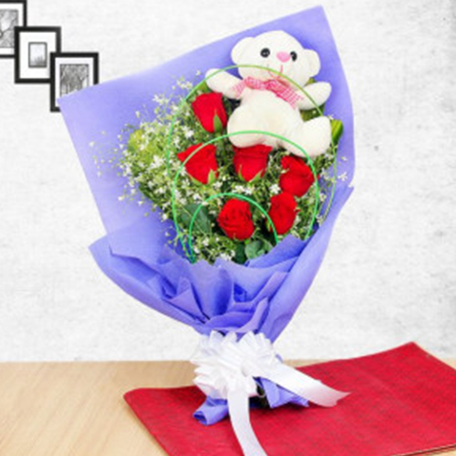Bouquet with a lovely teddy on the top