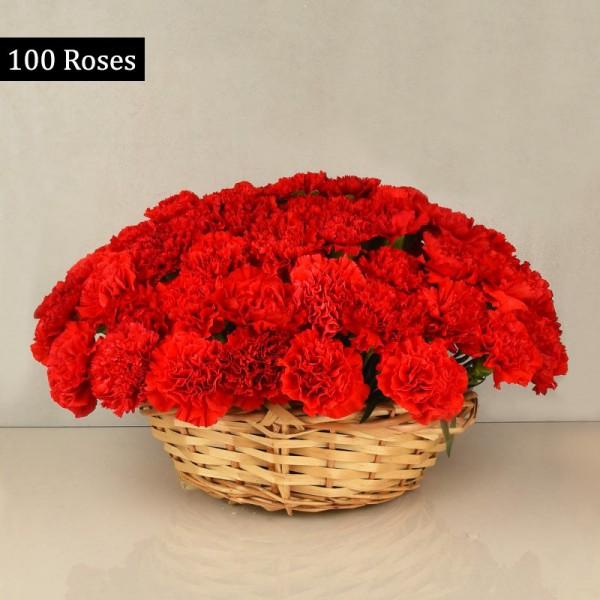 100 Red Carnations Basket Arrangement