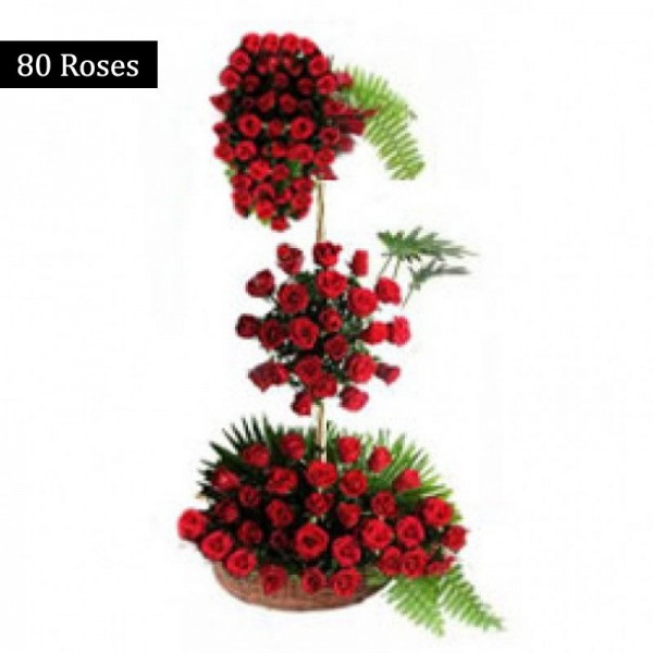 3 tiered floral arrangement of 80 Red Roses in a Basket
