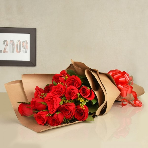 15 Red Roses wrapped in Special Paper