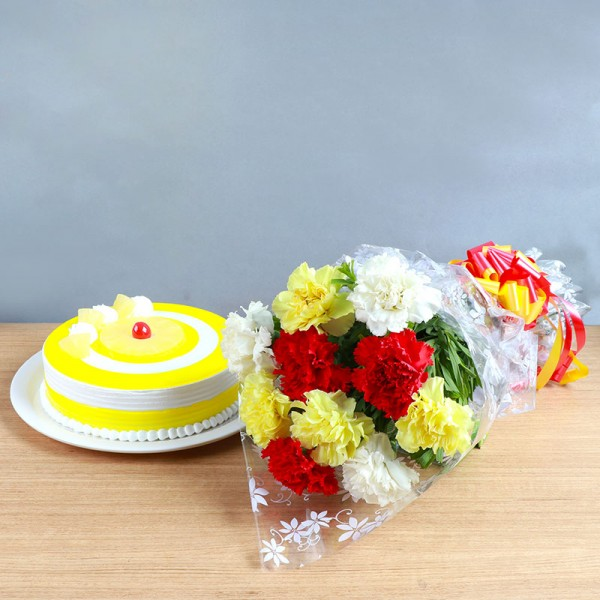 One Bouquet of 10 Mixed Carnations (4 Yellow,3 Red and 3 White) in Cellophane Packing with 1/2 Kg Pineapple Cake