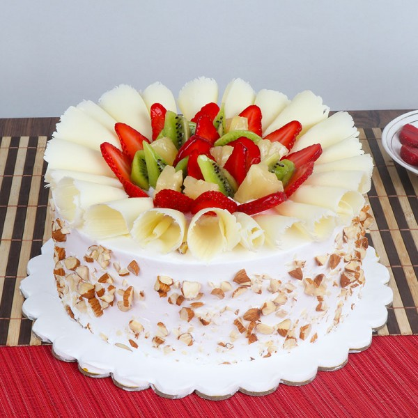 Half Kg Pineapple Fruit Cake Topped with Fresh Fruits and White Chocolates