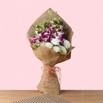 6 Purple orchids and 5 White Carnations in Jute Packing
