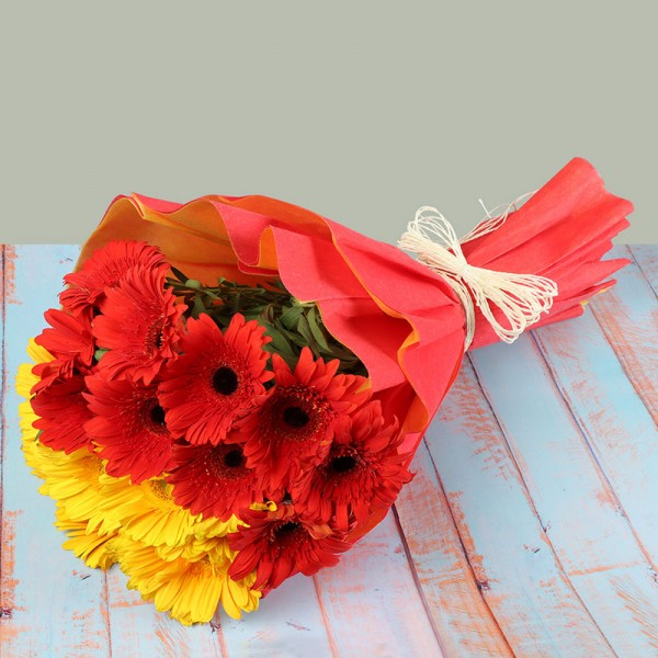 15 Gerberas (7 yellow+8 Red) in Paper Packing