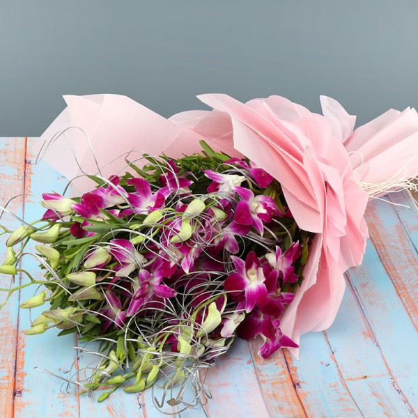 7 Purple Orchids wrapped in special Paper