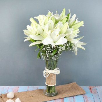 6 White Asiatic Lilies in a Glass Vase wrapped with jute