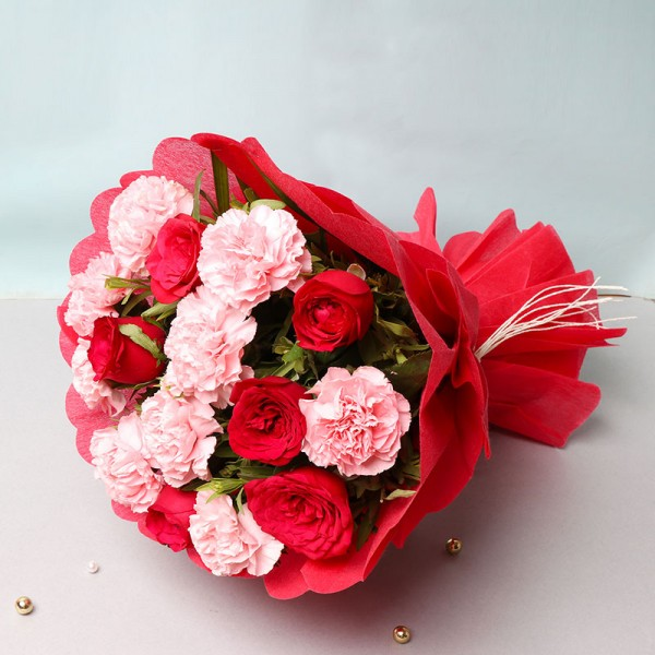 6 Red Roses and 9 Pink Carnations in a Paper Packing