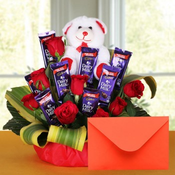 8 Red Roses with 8 Cadbury's DairyMilk Chocolates (14gms each) and Teddy Bear (6 inches) and Greeting Card in a Basket