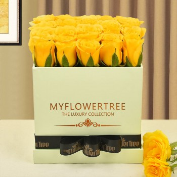 30 yellow roses in lime green box tied with black ribbon