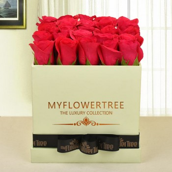 30 dark pink roses in lime green box tied with black ribbon