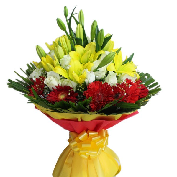 12 white Roses with 10 red Gerberas and 6 yellow Lilies which is wrapped with colored paper packing