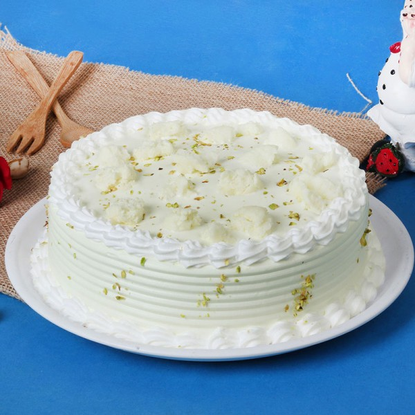 Half Kg Rasmalai Vanilla Cake garnished with Pista