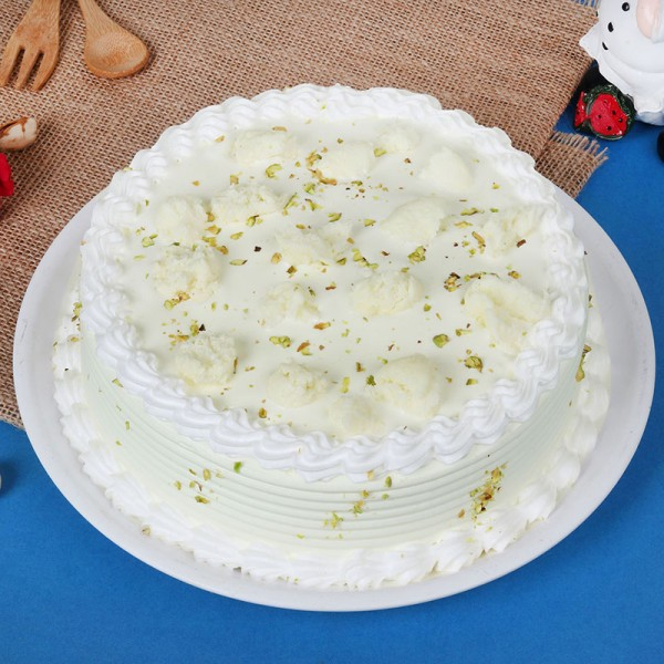 Rasmalai Vanilla Cake garnished with Pista. Front view!