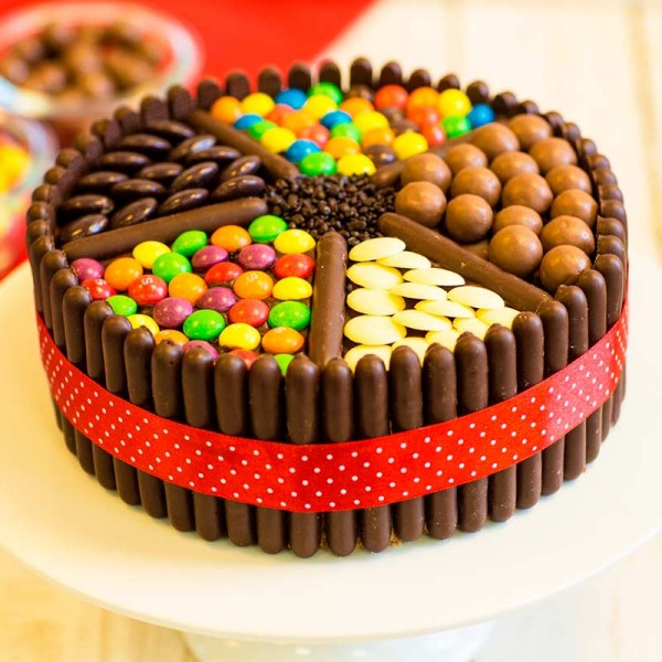 One Kg Chocolate Cream Cake Decorated with Kitkat, Gems, and chocolate candies
