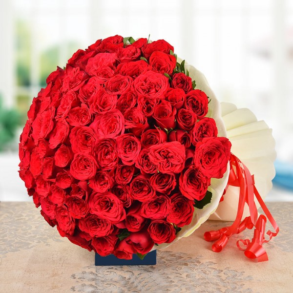 100 Red Roses in Paper Packing