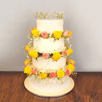 7 Kg 4 Tier Vanilla Cake decorated with 50 (pink and yellow roses)