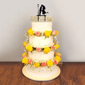 7 Kg 4 Tier Vanilla Cake decorated with 50 (pink and yellow roses) with Couple Silhoutte