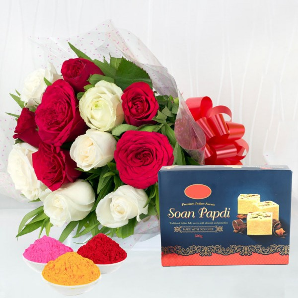 12 Red and White Roses in Cellophane Packing with Red Bow with Soan Papdi ( 250 gm) and Red Gulal Small Pouch and Pink Gulal Small Pouch and Yellow Gulal Small Pouch