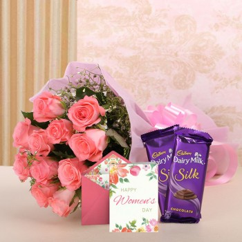 12 Pink Roses in Pink Paper with 2 Cadbury's Silk (60gms each) and 1 Greeting Card for womens day