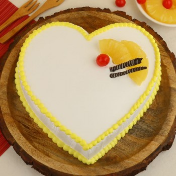 Half Kg Heart Shape Pineapple Cake