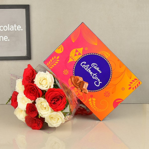 12 Red and White Roses in Cellophane Packing with Cadbury's Celebrations (131.3 gms)