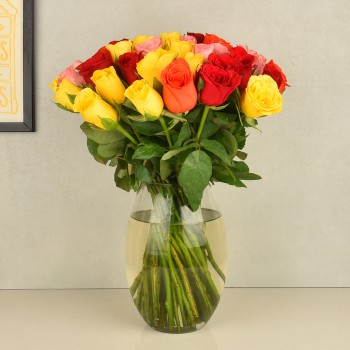 50 Assorted Roses in a Glass Vase