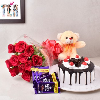 12 Red Roses with 5 Cadbury's DairyMilk Chocolates (13.2 gm) and Half Kg Black Forest Cake and Teddy Bear (6inches)