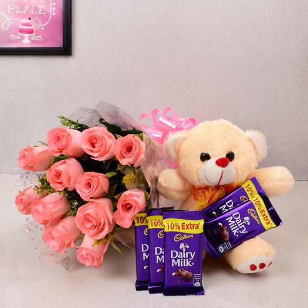 12 Pink Roses with Teddy Bear (6 inches) and 5 Cadbury's DairyMilk Chocolates (13.2 gms each)