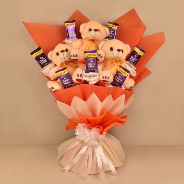 Bouquet of 6 inches 3 Teddy and 6 Dairy Milk 13.2 gm Chocolates in Paper Packing