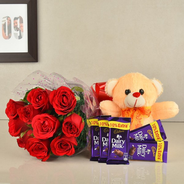 10 Red Roses with Teddy bear (6 inch) and 5 Dairy Milk (13.2 gm)