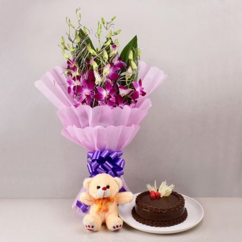 6 Purple Orchids in Paper Packing with Half Kg Chocolate Cake and Teddy Bear (6 inch)