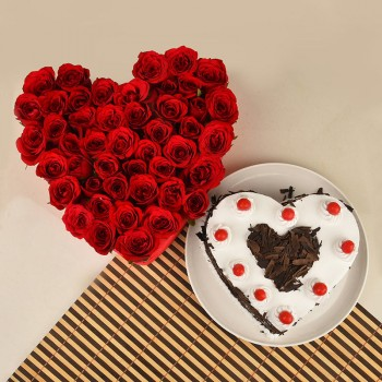 Heart Shaped Arrangement of 50 Red Roses with 1 Kg Heart Shape Black Forest Cake