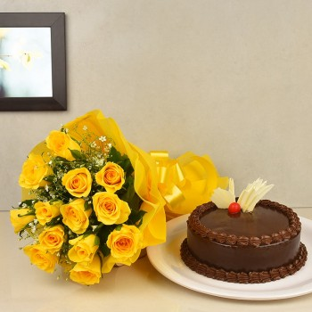 12 Yellow Roses wrapped in yellow paper packing with Half Kg Chocolate Cake