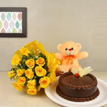 12 Yellow Roses in Paper packing with Half Kg Chocolate Cake and Teddy Bear (6 inch)