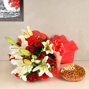 12 Red Roses in Paper packing with 4 White Oriental Lilies and 250 gm Assorted DryFruits(Almond,Cashew nut,Raisins)