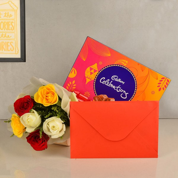 6 Assorted Roses wrapped in White paper with a box of Cadbury's Celebrations (125.3 gms) and 1 Greeting Card