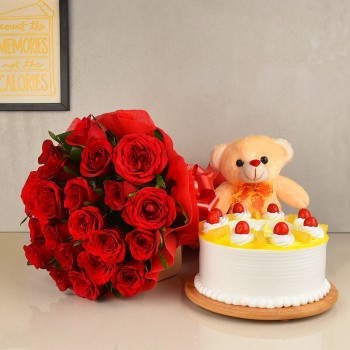 20 Red Roses wrapped in crape paper with Half Kg Pineapple Cake and 6 Inches Pink Teddy