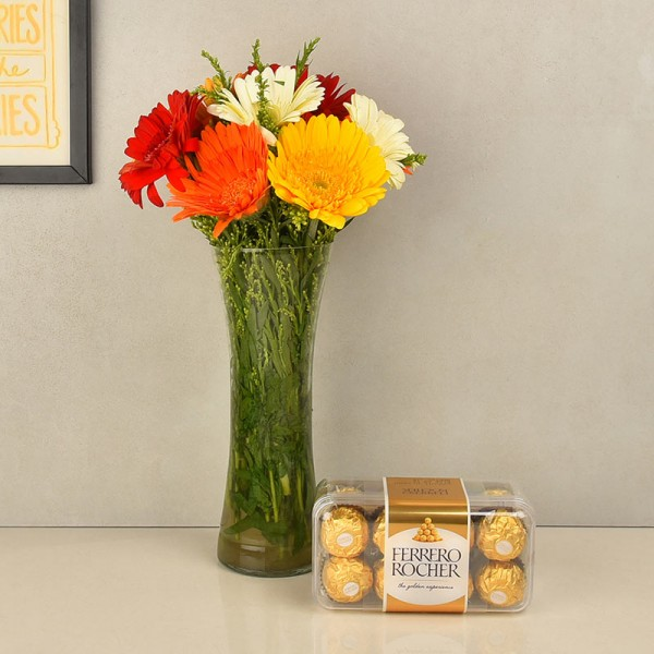12 Assorted Gerberas in Glass Vase with a box of 16 pcs of Ferrero Rocher