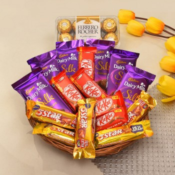 Basket of 5 kitkat (13.2gms each), 5 5star (22.4gms each), 6 DiaryMilk silk (60 gms each) and 16pcs ferrero rochers (200gms)