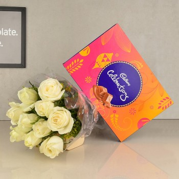10 white roses in cellophane with One Celebration Box( 125.2 gms)