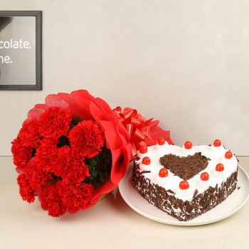 12 Red Carnations with 1 Kg Heart Shape Black Forest Cake