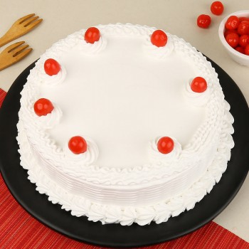 Half Kg Vanilla Cream Cake Topped with Cherries