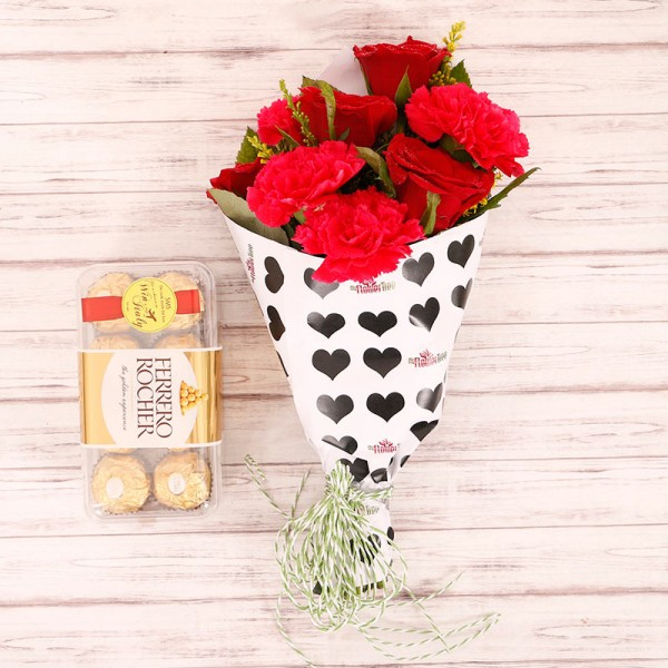 4 Red Roses and 4 Red Carnations with 16 Pcs Ferrero Rocher in Special Heart Print Paper