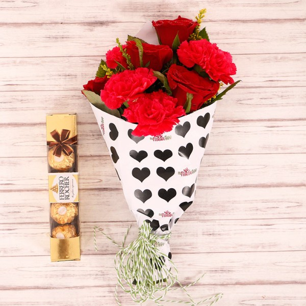 4 Red Roses and 4 Red Carnations with 4 Pcs Ferrero Rocher in Special Heart Print Paper