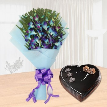 6 Blue Orchids with 1 Kg Heart Shaped Chocolate Truffle Cake in Blue Paper Packing