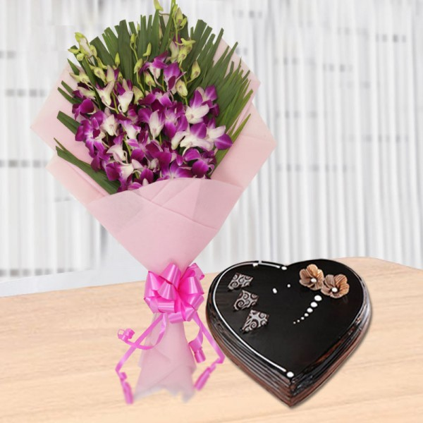 6 Purple Orchids with 1 Kg Heart Shape Chocolate Cake in Paper Packing