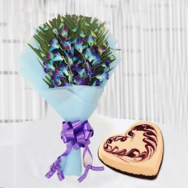 6 Blue Orchids with 1 Kg Heart Shape Strawberry Cheesecake in Paper Packing